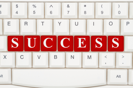website words: Finding success on the internet, A close-up of a keyboard with red highlighted text Success
