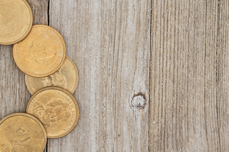 space wood: Retro money background USA gold coins on a weathered wood background with copy space