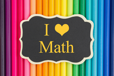 i like my school: I love math  text on a chalkboard with colorful pencil crayons Stock Photo