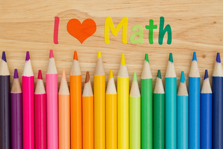 i like my school: I love math  text with colorful pencil crayons on a desk