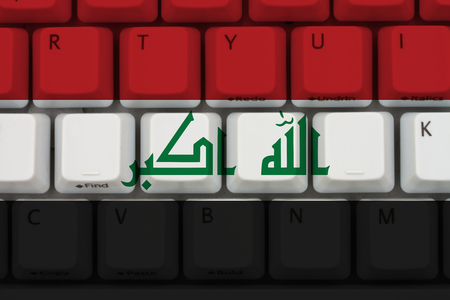 Internet access in Iraq, The Iraqi flag on a computer keyboard Stock Photo