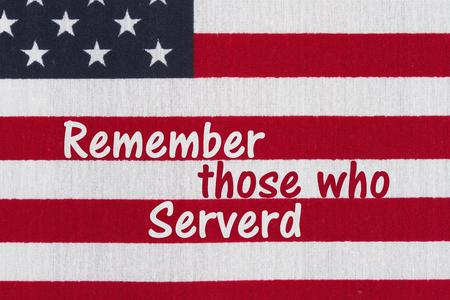 those: USA patriotic message, Close-up of the USA stars and strips flag with text Remember those who Served Stock Photo