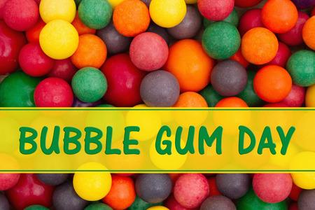multicolored gumballs: Bubble Gum Day message, Colorful multi colored bubble gum background with text Bubble Gum Day Stock Photo