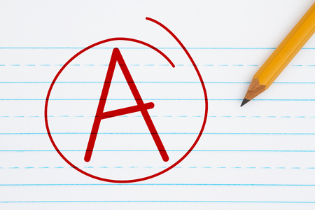 Getting a grade A, Retro lined paper with a pencil with text A and a circle in red Stock Photo