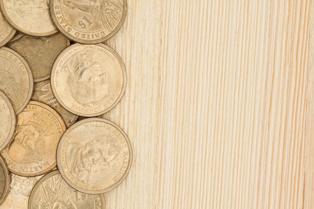 blank spaces: Gold coin money background, USA gold one dollar coins on a wood desk with copy space Stock Photo