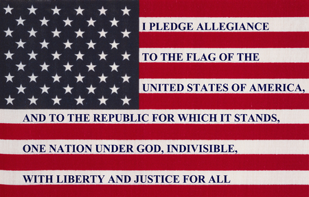 pledge of allegiance: The pledge of allegiance written on the United States of America flag