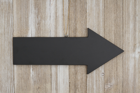 blank spaces: Arrow chalkboard sign on weathered wood with copy space for your message