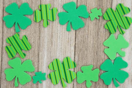 Saint Patricks Day background, Green shamrocks on weathered wood background Stock Photo