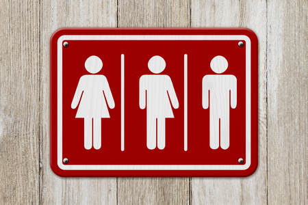 trans gender: All inclusive transgender sign, Red and white sign with a woman, a transgender and man symbol on weathered wood