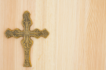 space wood: A gold detailed cross on wood with copy space