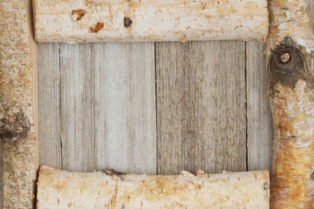 space wood: Birch log frame on weathered wood with copy space for your message Stock Photo