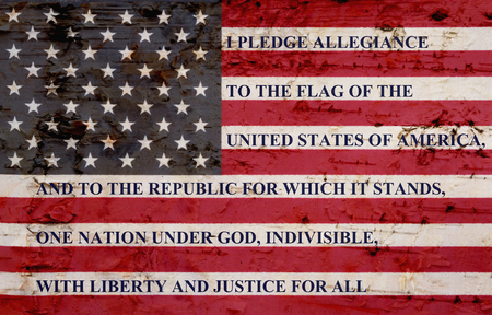 The pledge of allegiance written on a weathered United States of America flag Stock Photo - 80257831