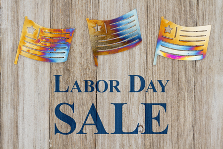 Labor Day Sale text with USA patriotic old metal flags on a weathered wood Stock Photo