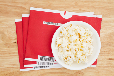 South Carolina, USA Aug 2017. Illustrative editorial image of Netflix red mailing envelopes with popcorn. Netflix is very popular in the USA Stock Photo