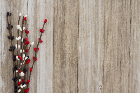 Red, white and blue pip floral berry spray on weathered wood background with copy space for your message