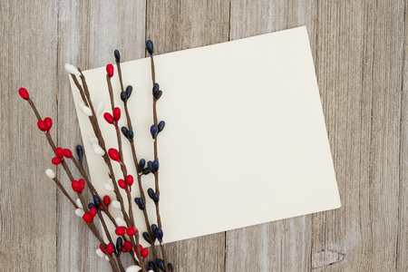 A blank greeting card on weathered wood and with pip berry spray with copy space for your message