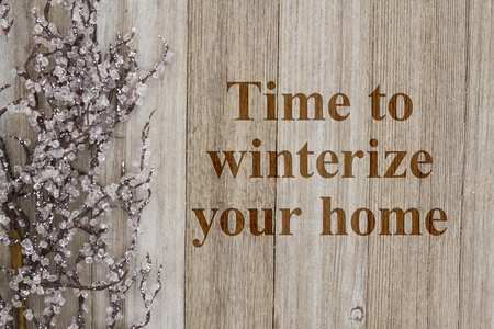 Time to winterize your home text with a iced tree branch on weathered wood