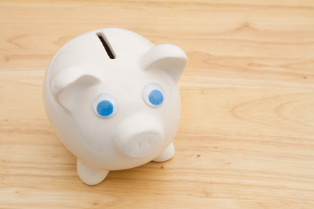 Your savings, A piggy bank on a desk Banco de Imagens
