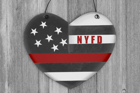 Retro USA thin red line flag on a heart shape wood sign with text NYFD on weathered wood