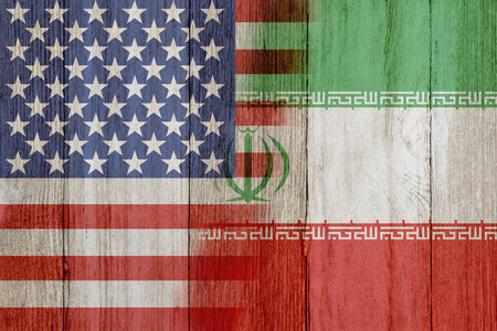 Relationship between the USA and Iran, The flags of USA and Iran merged on weathered wood Standard-Bild