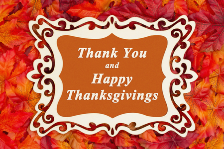 Happy Thanksgiving greeting with a fancy wood frame and fall leaves with Thank You