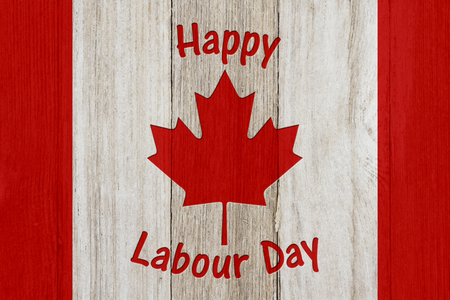 Happy Labour Day for Canda on weathered wood with a flag design