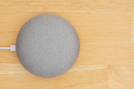 South Carolina, USA Oct 2018. Illustrative editorial image of  a Google home mini device on a wood desk