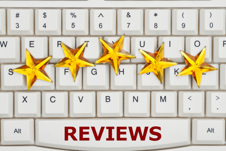Reviews on the Internet, A close-up of a keyboard with five gold stars with text Reviews