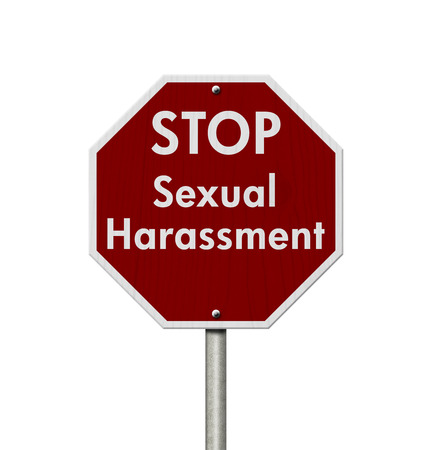 Red and white stop sign with words Stop Sexual Harassment
