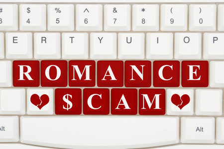 Dating scams on the internet, A close-up of a keyboard with red highlighted text Romance Scam