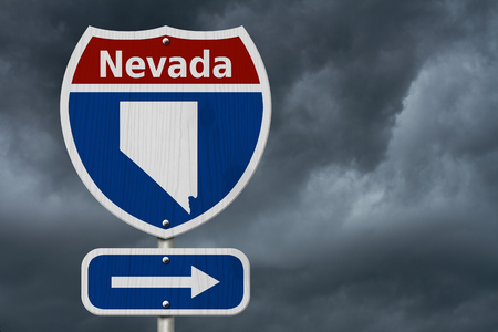 Road trip to Nevada, Red, white and blue interstate highway road sign with word Nevada 스톡 콘텐츠