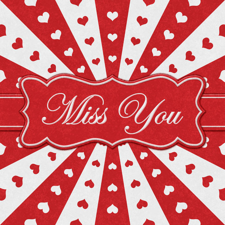 Miss You message on a ribbon with with red hearts with red and white burst lines