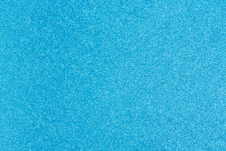 Bright blue glitter paper  with copy-space for your message and useful for textures of text and objects
