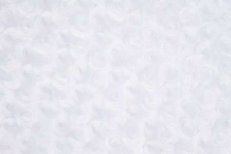 White rose plush fabric background with muted mix of shades to provide copy-space for your message