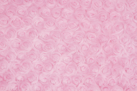 Pale pink rose plush fabric background with muted mix of shades to provide copy-space for your message