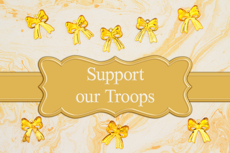 Support our Troops message with yellow ribbons on yellow textured watercolor paper Фото со стока