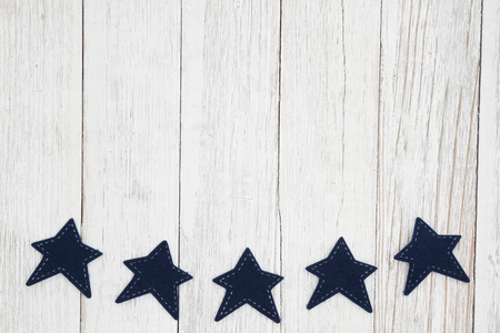 Blue stars on weathered whitewash textured wood with copy space for your message