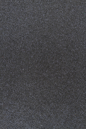 Black glitter paper background with copy-space for your message and useful for textures of text and objects Imagens
