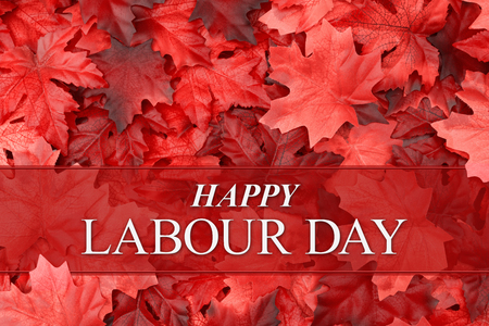 Happy Labour Day greeting with red fall leaves with Canadian and UK spelling