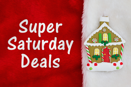 Super Saturday Deals message with Christmas gingerbread house on red and white plush textured fabric stocking