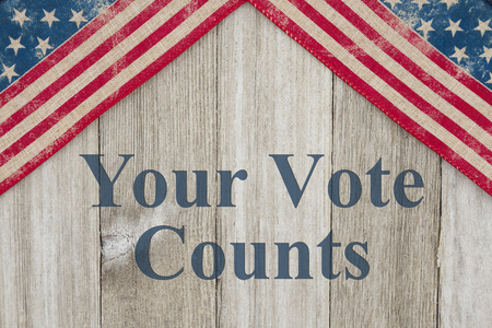 America patriotic message, USA patriotic old flag on a weathered wood background with text Your Vote Counts