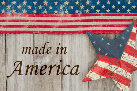 Made in America message, USA patriotic old flag and a star and weathered wood background with text Made in America