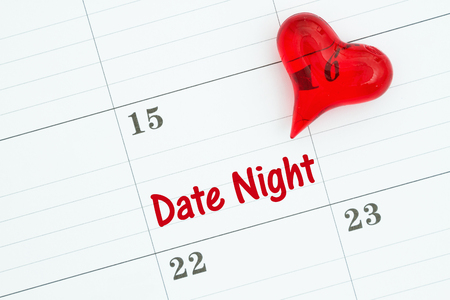Scheduling your date night message with a monthly calendar with a red heart