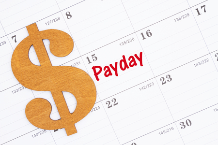 Time for payday message on a monthly calendar with a gold dollar sign