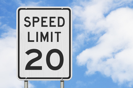 US 20 mph Speed Limit sign isolated with sky Stock Photo