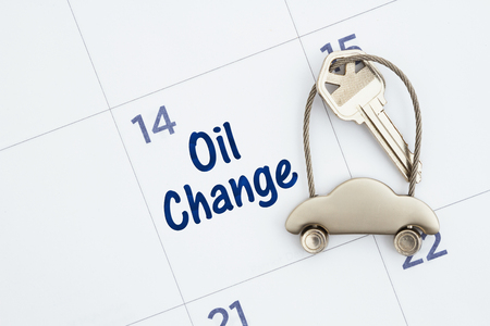 Schedule an oil change message with monthly calendar with car keys