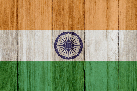 A rustic old Indian flag on weathered wood for a background Stock Photo - 120552524
