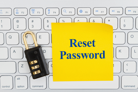 Reset password with combination lock on a keyboard with a sticky note