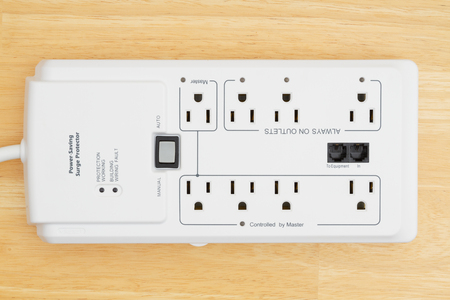 A  power saving surge protector on wood