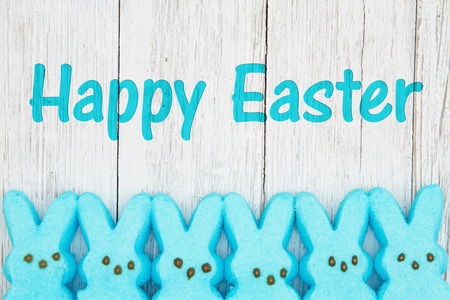 Happy Easter card with blue candy bunnies on weathered whitewash wood